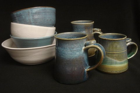 Wheel-thrown bowls and coffee mugs