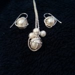 White wrapped pearl cluster set with matching earrings