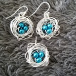 Wire-wrapped silver bird nest earring & pendant set with bright turquoise beads