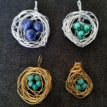 Four wire-wrapped bird nest pendants
